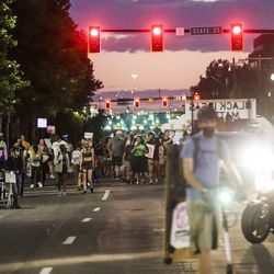Black Lives Matter demonstrators dance to music as they walk behind a truck pulling a sound system on 600 South in Salt Lake City on Friday, July 3, 2020.