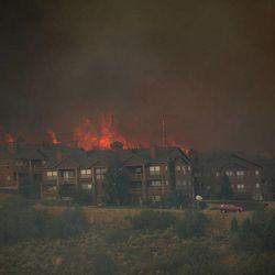 A wild fire grows near the Jordanelle Reservoir on Saturday, Aug. 18, 2012.
