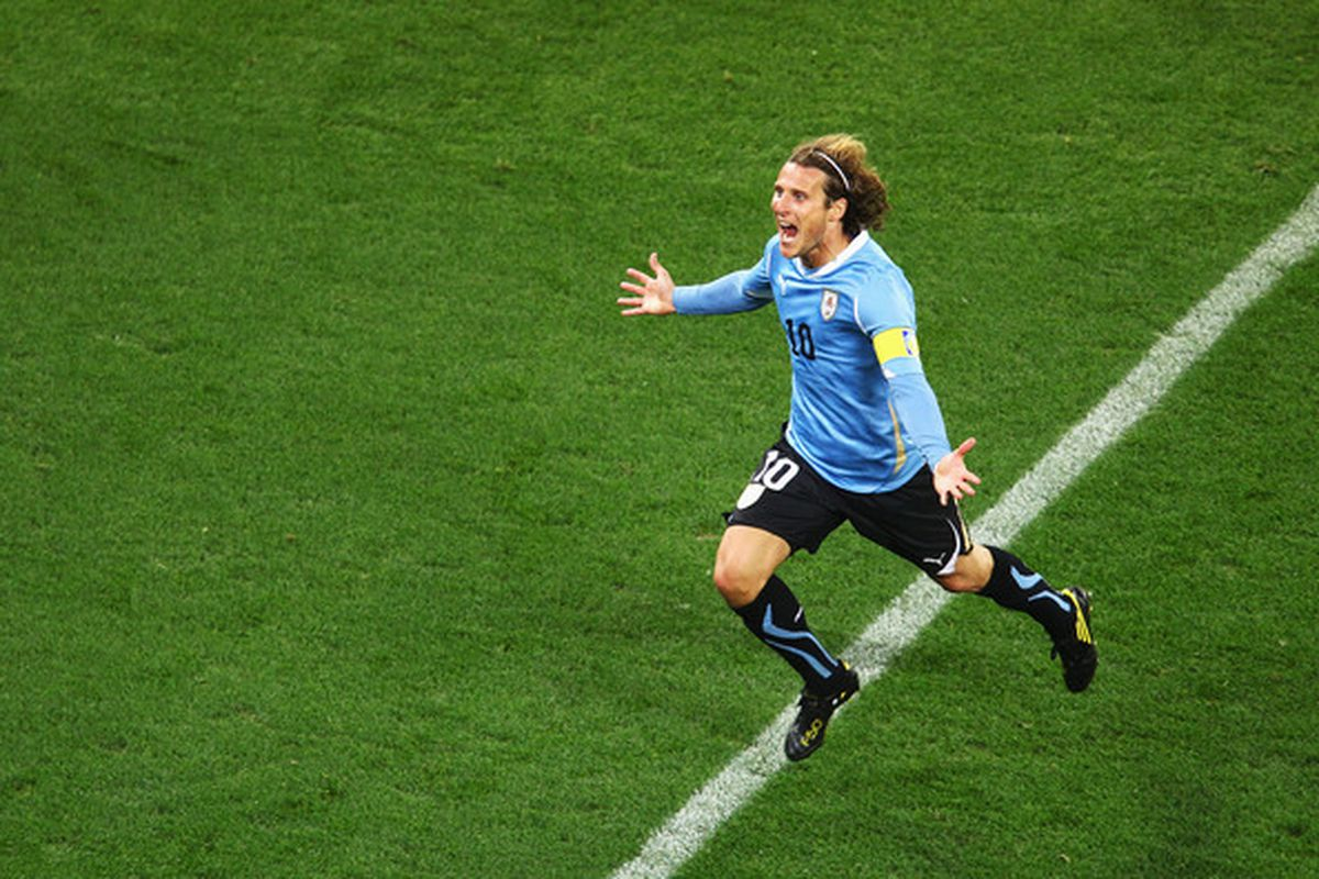 CAPE TOWN SOUTH AFRICA - Diego Forlan positively prances across the pitch after netting a goal. (Photo by Richard Heathcote/Getty Images)