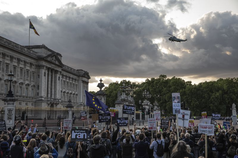 Anti-Trump protesters gather outside of Buckingham Palace as Marine One flies in on June 3, 2019.