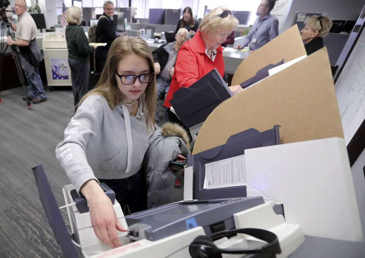 Amanda Peterson votes on the first day of early voting at the Salt Lake County Clerk's Office in the Salt Lake County Government Center in Salt Lake City on Tuesday, Feb. 18, 2020.