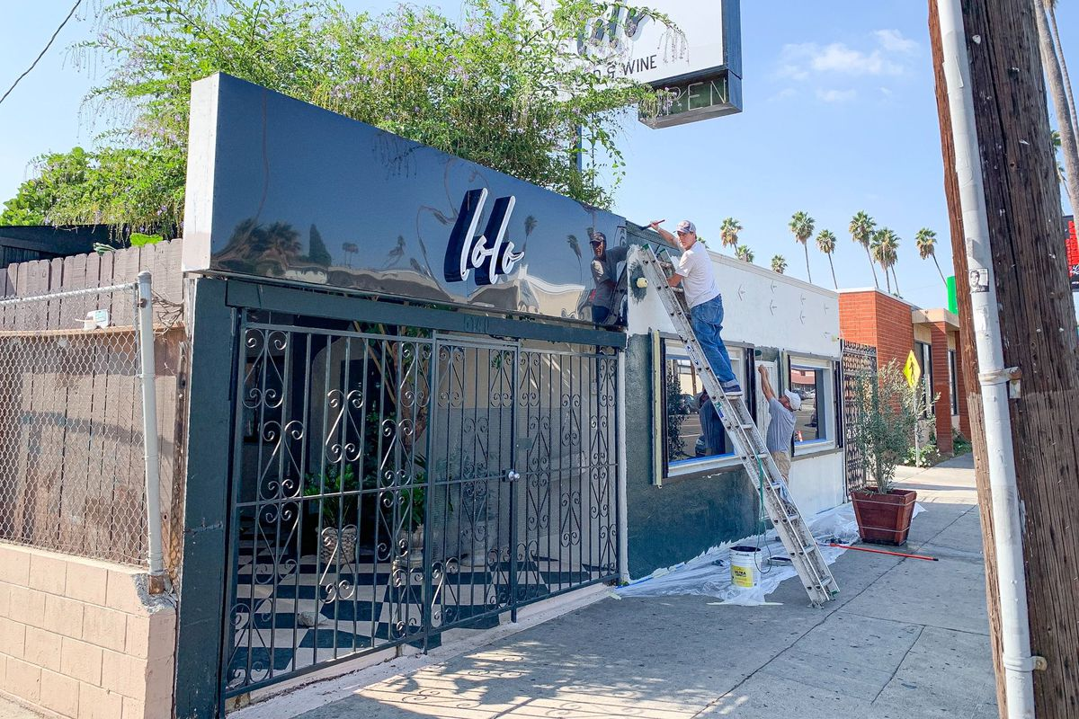Lolo Wine Bar and Restaurant gets a fresh coat of black paint on the exterior.