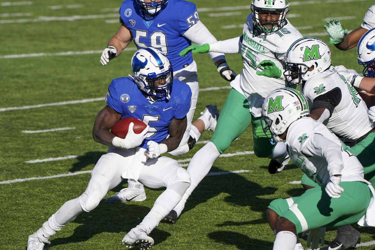 Buffalo Bulls running back Kevin Marks Jr. carries the ball against Marshall Thundering Herd during the first half at Cramton Bowl Stadium.