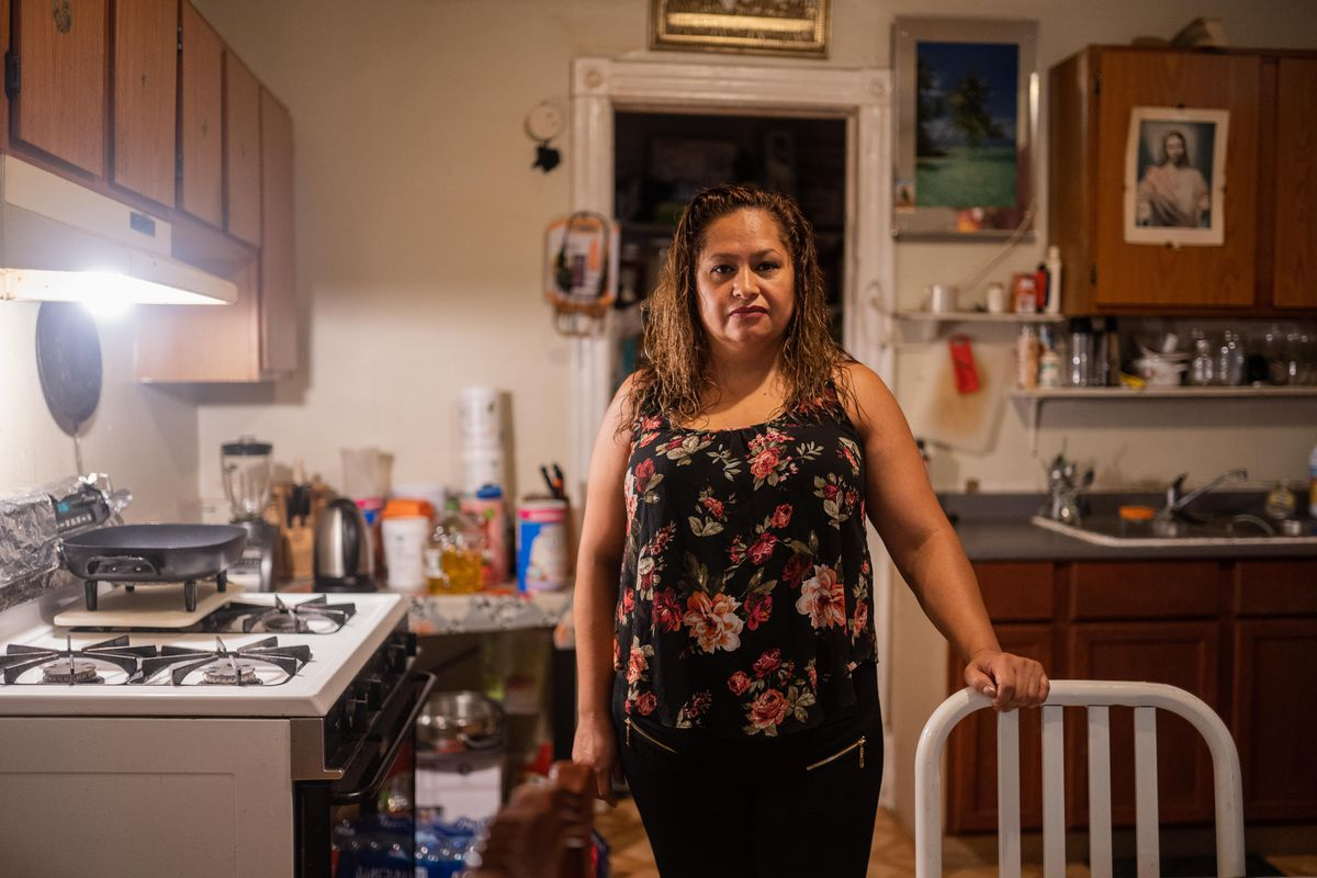 Patricia Vazquez, who says her gas was shut off when she fell behind on payments, poses for a portrait in her kitchen, Saturday morning, July 31, 2021.