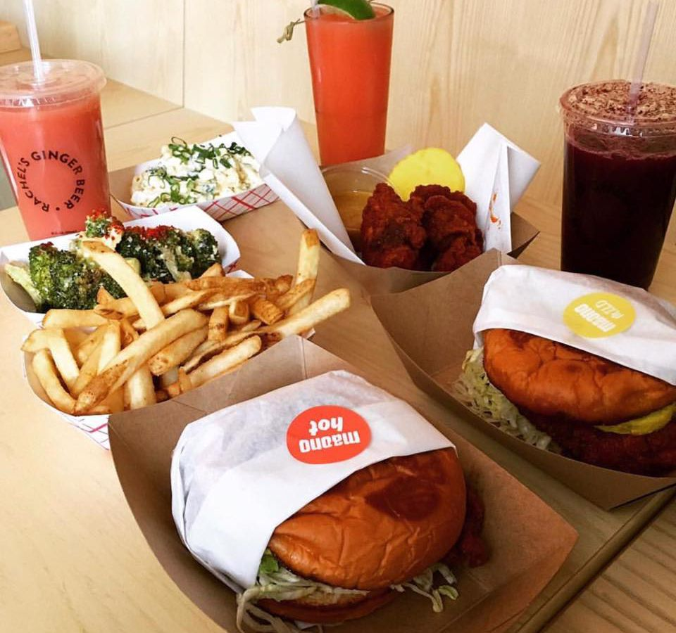 Three Rachel's Ginger Beer drinks and two Ma'ono fried chicken sandwiches with fries.