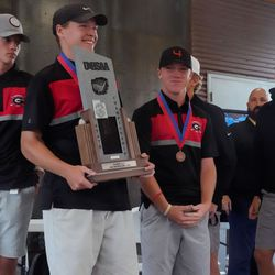 Grantsville High School receives the runners-up trophy in the 3A boys state championship at Oquirrh Hills Golf Course in Tooele on Thursday, Oct. 7, 2021.