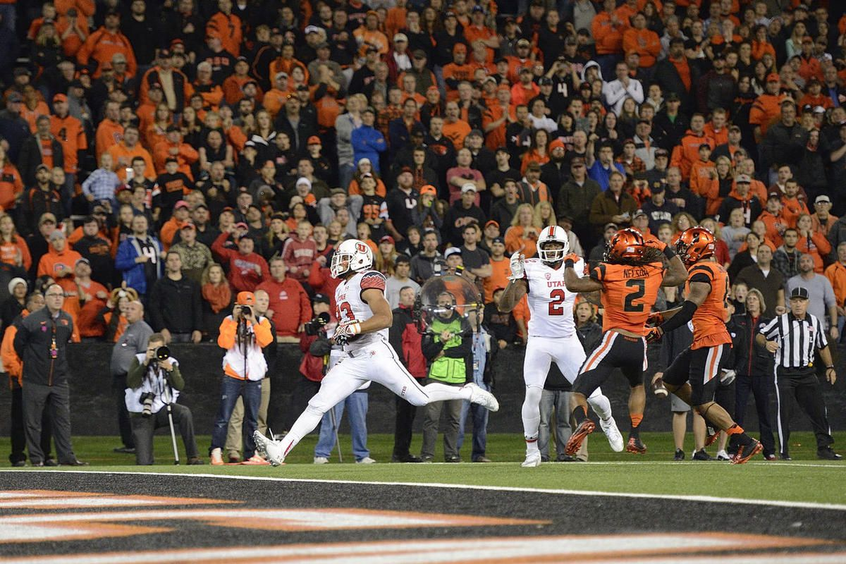 University of Utah running back Devontae Booker (23) scores a touchdown in overtime against Oregon State University during an NCAA college football game in Corvallis, Ore., Thursday, Oct.. 16, 2014. The University of Utah beat Oregon State 29-23.