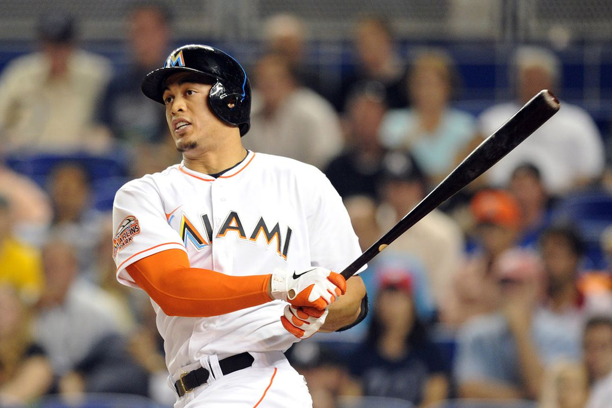 May 29, 2012; Miami, FL, USA; Miami Marlins right fielder Giancarlo Stanton (27) connects for an RBI double during the sixth inning against the Washington Nationals at Marlins Park. Mandatory Credit: Steve Mitchell-US PRESSWIRE
