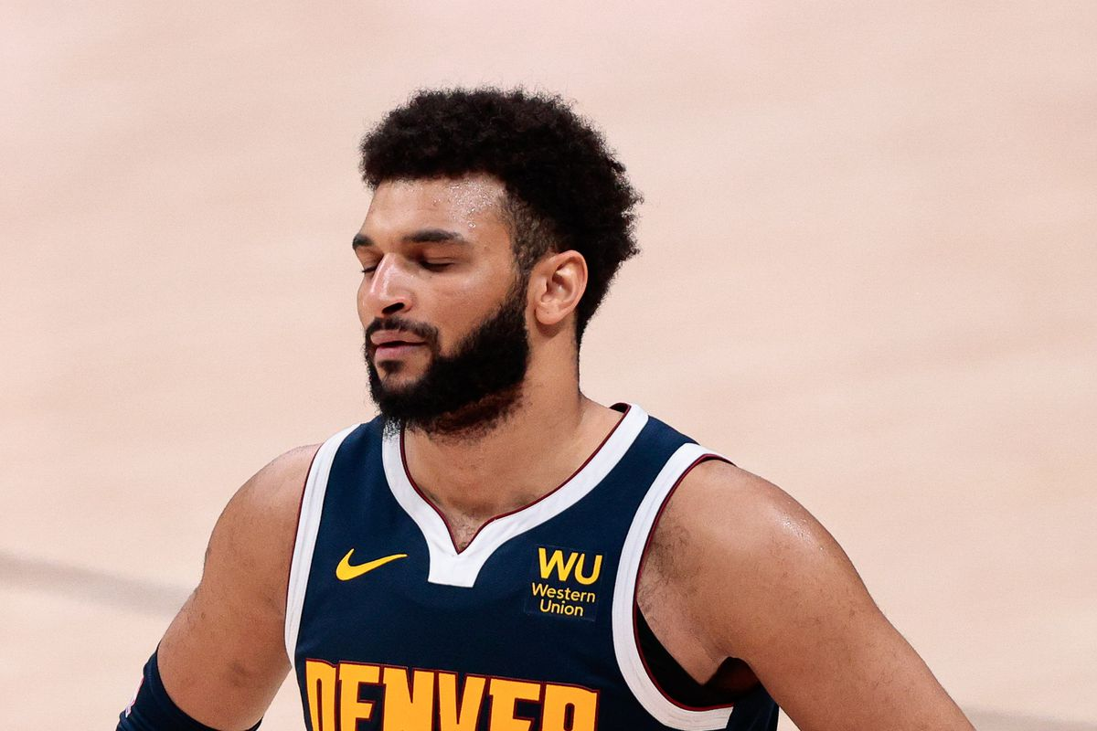 Denver Nuggets guard Jamal Murray reacts in the fourth quarter against the New Orleans Pelicans at Ball Arena.