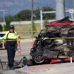 Emergency responders work at the scene of a fatal accident involving two vehicles at the intersection of 5400 South and 2700 West in Taylorsville on Saturday, June 3, 2017.