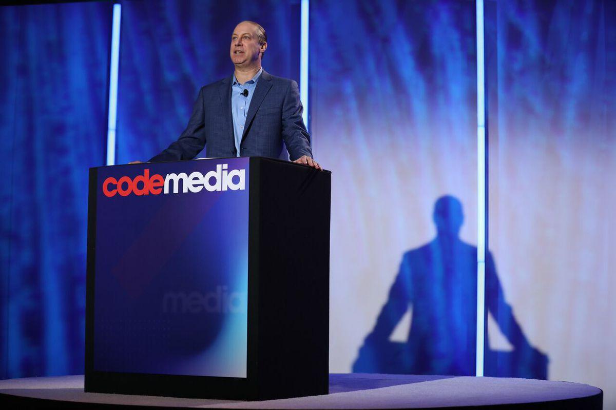 MoffettNathanson analyst Michael Nathanson onstage behind a podium at Code Media