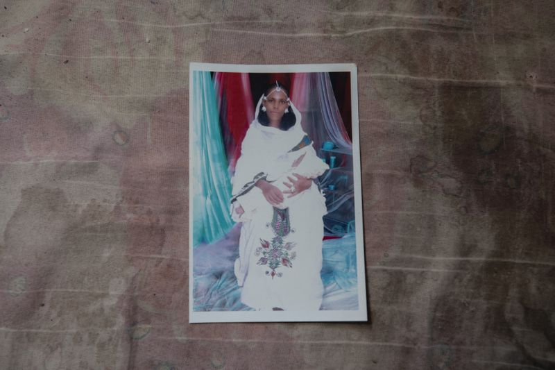 A photograph of Letay, the deceased wife of 40-year-old Tigrayan Abraha Kinfe Gebremariam, inside her family's shelter in Hamdayet iin eastern Sudan, near the border with Ethiopia. Ten days after giving birth to twin daughters in the Tigrayan region of Ethiopia, she died, unable amid an ethnic war, to have gotten medical help.