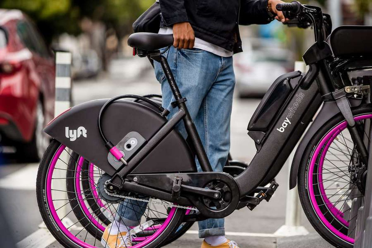 A black and pink e-bike with the Lyft logo.