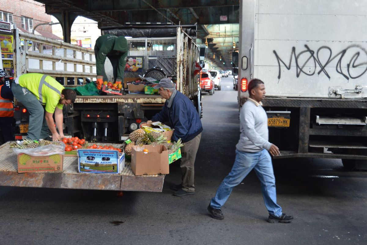 Sanitation crew removes cart and goods, Roosevelt Ave.