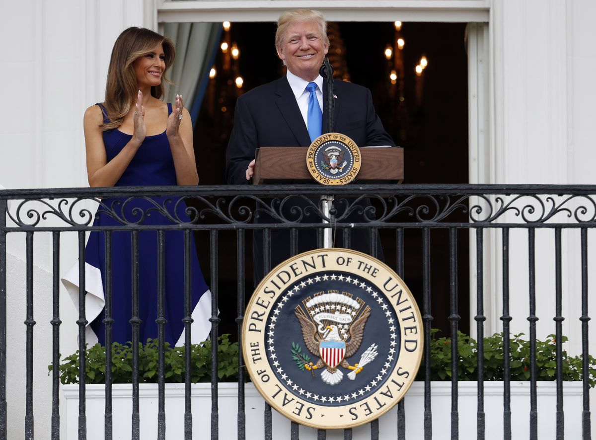 President Donald Trump, with first lady Melania Trump, spoke from the Truman Balcony at the Fourth of July picnic for military families on the South Lawn of the White House on Tuesday.   Alex Brandon/Associated Press