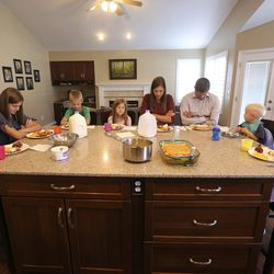Grace, Camilla, Dallin, Caroline, Laura, Matthew, James and Mary Grant say a prayer before dinner in Midvale, Utah, on Monday, Sept. 9, 2019.