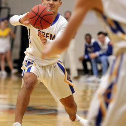 Orem's Puka Nacua passes the ball during a Vivint Great Western Shootout basketball game against the British Columbia Christian Panthers at Orem High School in Orem on Friday, Dec. 8, 2017. Orem won 63-56.