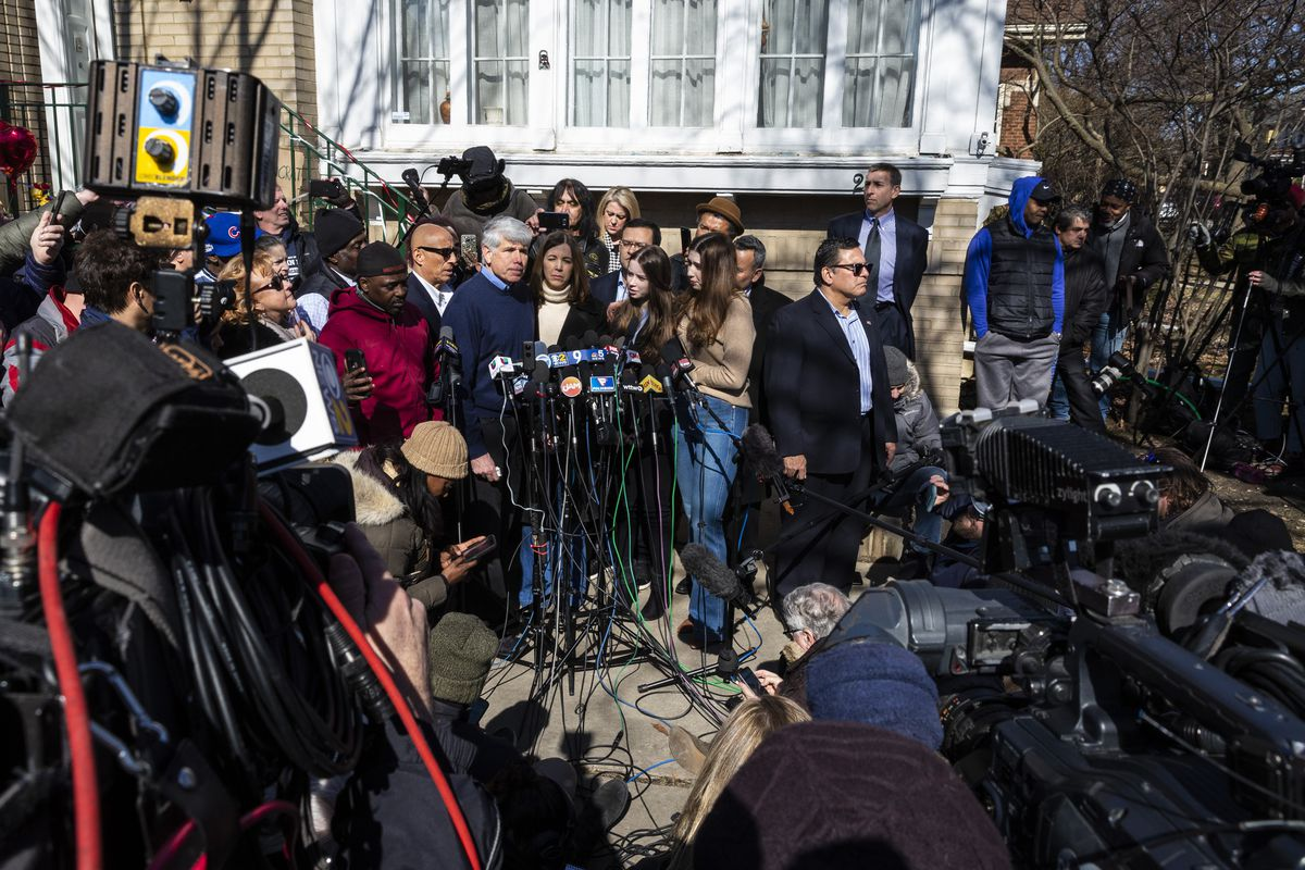 Former Illinois Gov. Rod Blagojevich's wife, Patti Blagojevich, and their two daughters, Annie and Amy (right), look on as he speaks to reporters outside the family's Ravenswood Manor home on Wednesday.