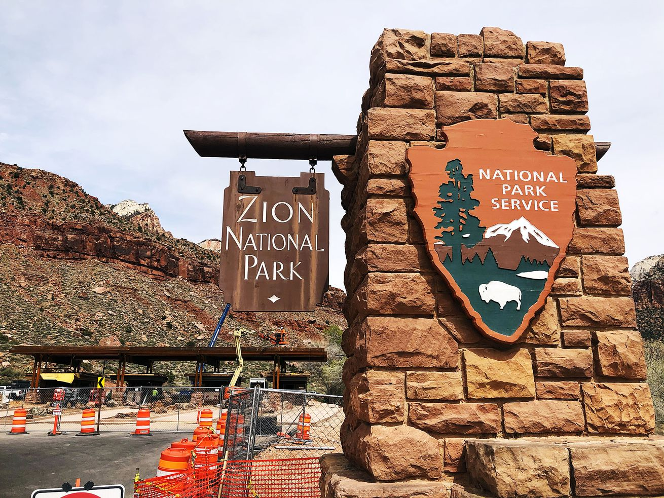 The entrance to Zion National Park is pictured on Wednesday, March 25, 2020. At back left, new entrance booths are under construction. The park was closed on Friday, April 3, 2020, to fight the coronavirus pandemic.