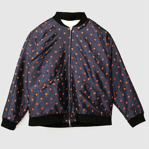 Navy blue bomber jacket with black edging and red floral embroidery.