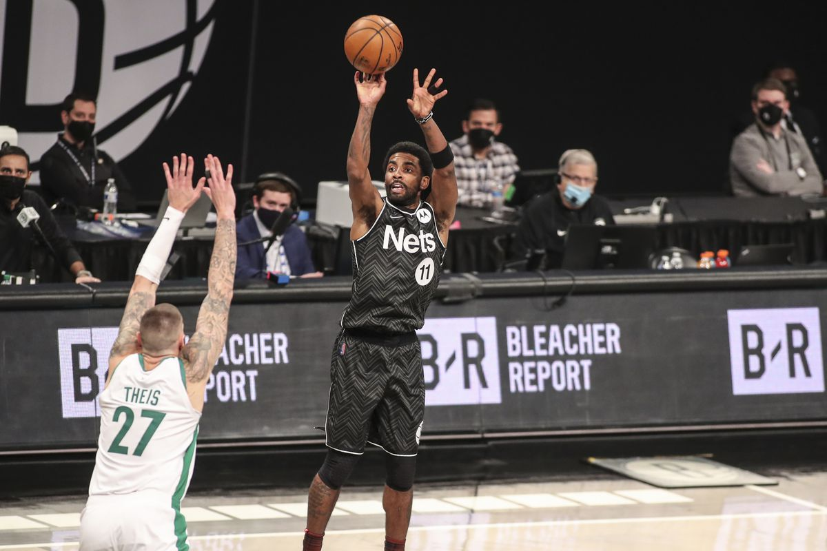 Brooklyn Nets guard Kyrie Irving (11) shoots a three point shot in the third quarter against the Boston Celtics at Barclays Center.