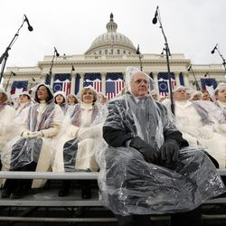 Members of the Mormon Tabernacle Choir sit in the rain waiting for the swearing in of Donald Trump as the 45th president of the United States to begin during the 58th Presidential Inauguration at the U.S. Capitol in Washington on Friday, Jan. 20, 2017.