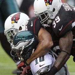 Philadelphia Eagles wide receiver DeSean Jackson, left, is tackled shy of the end zone by Arizona Cardinals safeties Kerry Rhodes, center, and James Sanders, right, to prevent a touchdown in the second quarter of an NFL football game on Sunday, Sept. 23, 2012, in Glendale, Ariz.