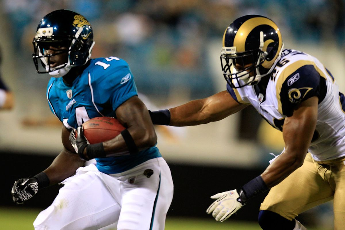 JACKSONVILLE, FL - SEPTEMBER 01:   Jonathan Nelson #26 of the St. Louis Ram attempts to tackleJamar Newsome #14 of the Jacksonville Jaguars at EverBank Field on September 1, 2011 in Jacksonville, Florida.  (Photo by Sam Greenwood/Getty Images)
