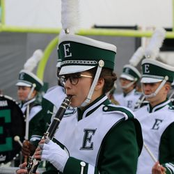 The band leaving the field before the game.