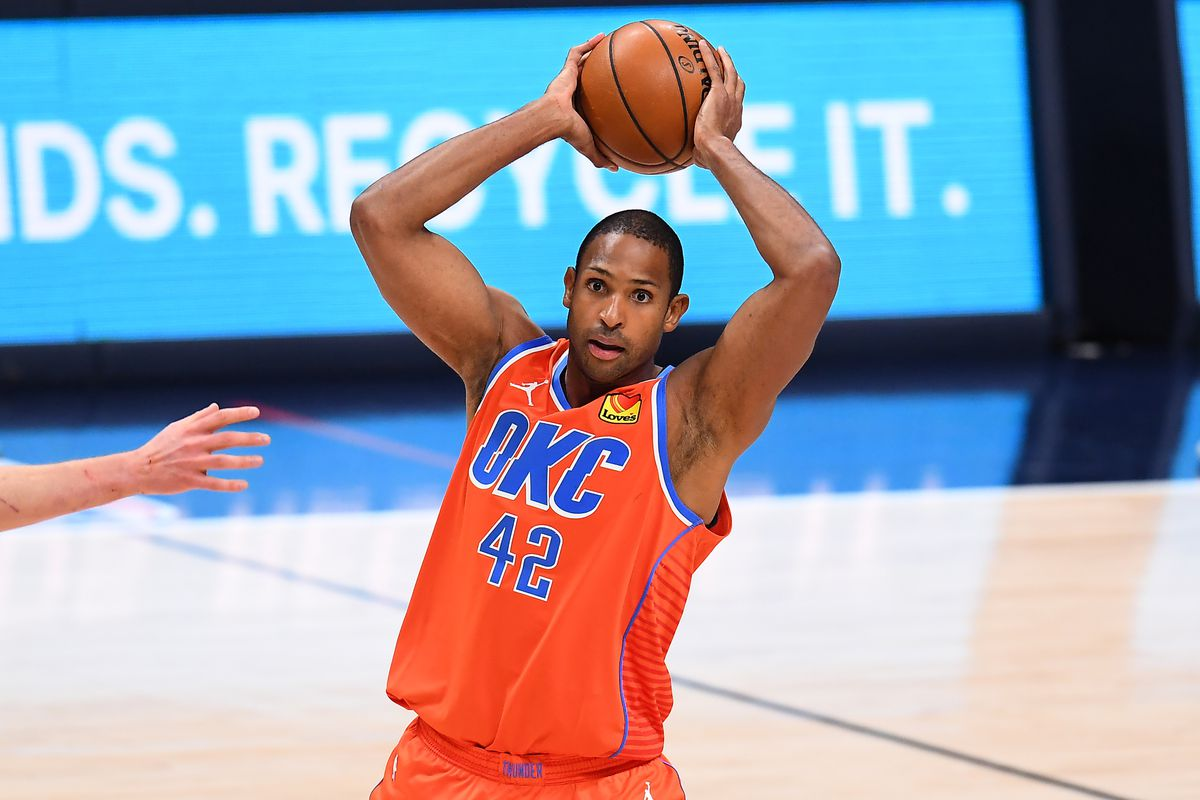 Oklahoma City Thunder center Al Horford prepares to pass the ball in the fourth quarter against the Denver Nuggets at Ball Arena.