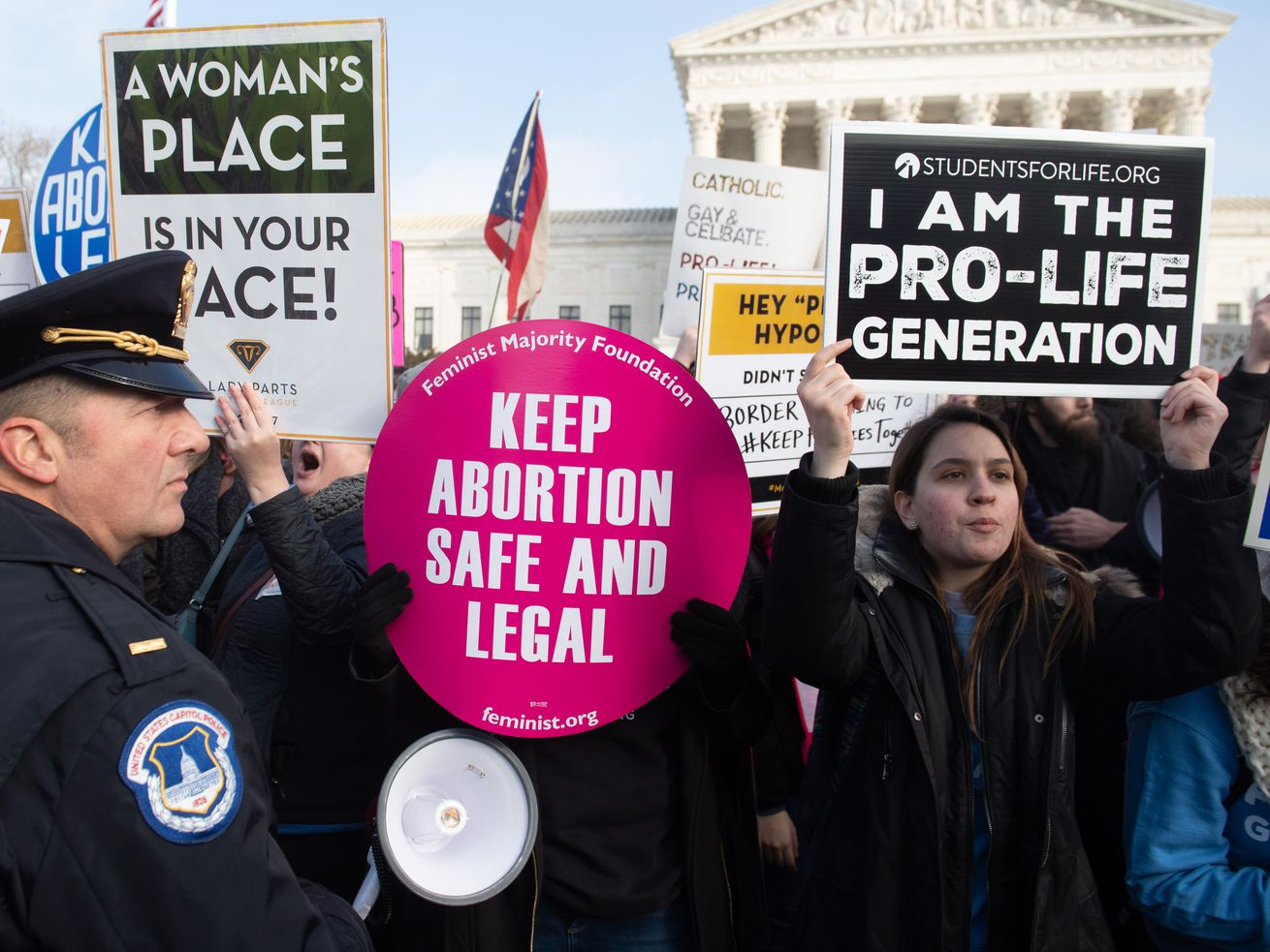 Activists on both sides of the abortion issue protest outside the US Supreme Court in Washington, DC, on January 18, 2019.