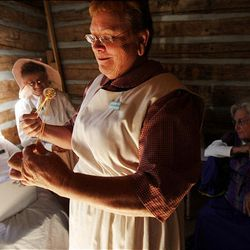 Raelou Elsberry, left, Dawn Warenski, Linda Quitner and Zoloma Goodall are members of the Daughters of the Utah Pioneers and helped in the restoration of the historic Santaquin cabin.