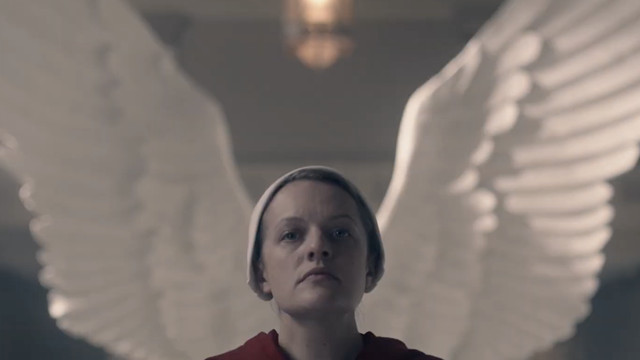 june in front of angel wings