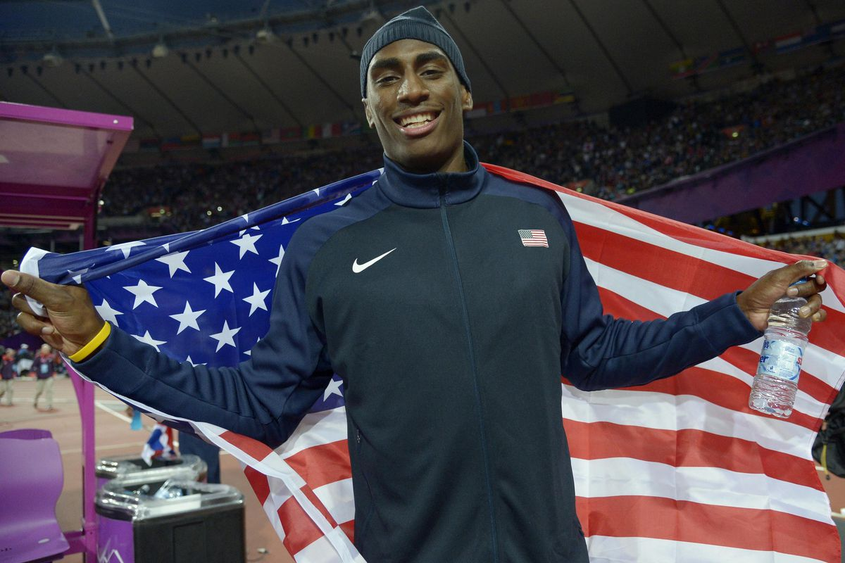 Aug 7, 2012; London, United Kingdom; Erik Kynard (USA) celebrates with an American flag after placing second in the men's high jump final during the 2012 London Olympic Games at Olympic Stadium. Mandatory Credit: Kirby Lee-USA TODAY Sports
