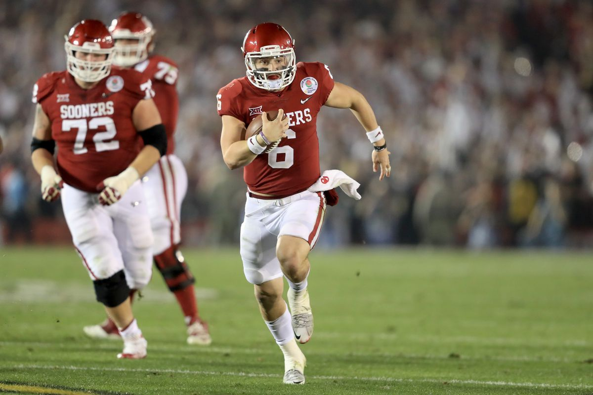 Oklahoma QB Baker Mayfield runs the ball against Georgia in the 2018 College Football Playoff Semifinal Game