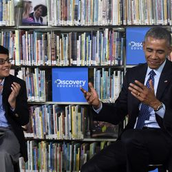 Former President Barack Obama attends an event at Anacostia Library in Washington on April 30, 2015. Unlike President Donald Trump, Obama was a big reader and even published a yearly summer reading list during his presidency.
