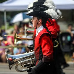 Members of the American Fork High School Marching Band take a break from playing during the Grand Parade in Provo on Monday, July 5, 2021.