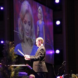 Dissolving images of guest artist Katherine Jenkins are displayed on a giant screen in LDS Conference Center auditorium as associate music director Ryan Murphy conducts during Mormon Tabernacle Choir and Orchestra at Temple Square dress rehearsal July 19, 2012 for Pioneer Day Concert.