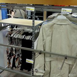 More empty racks where wallets and bags once stood.