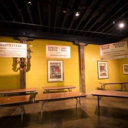 Signage for Boudin, Bourbon, and Beer also features silent auction items, such as dinners at participating chef's restaurants.