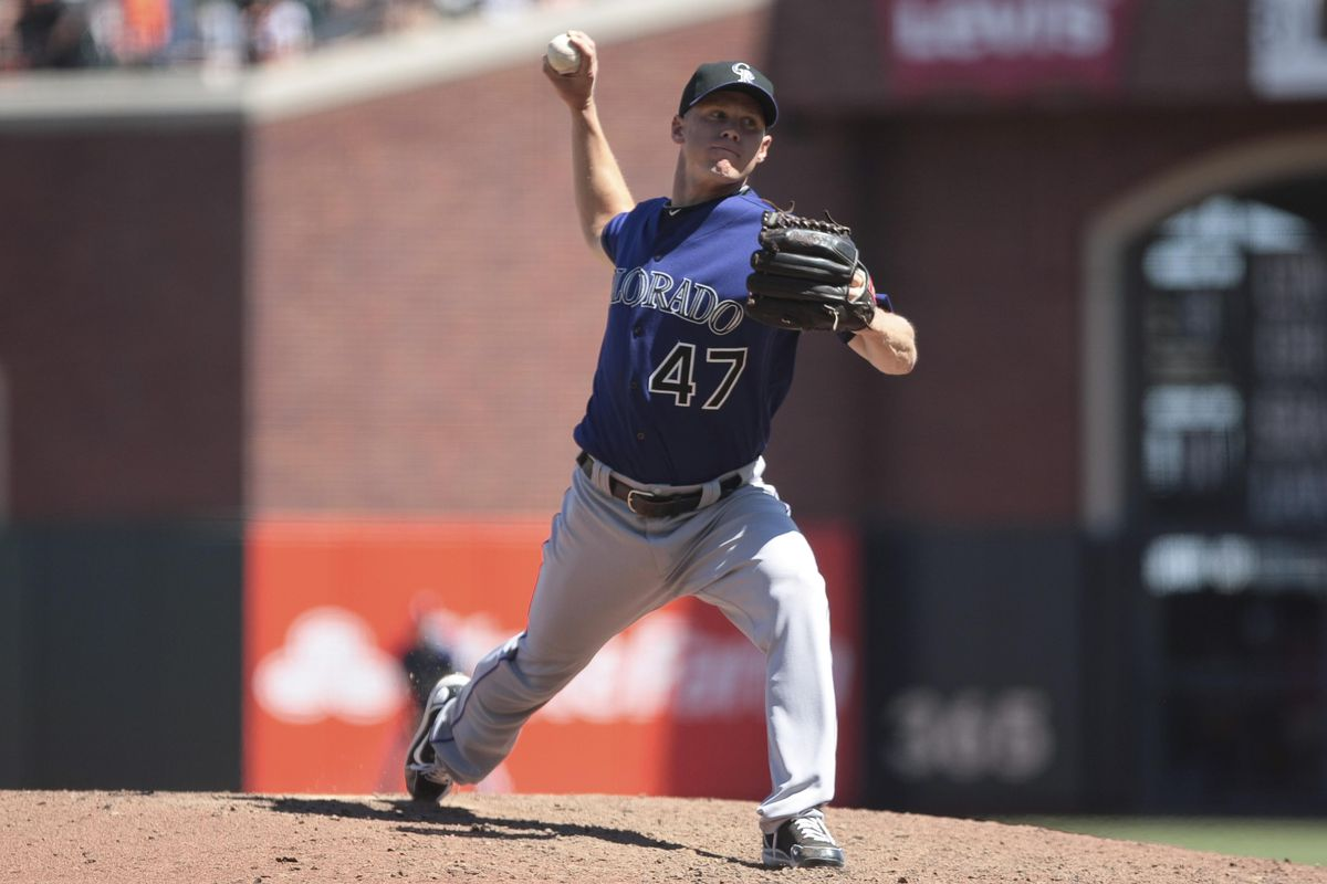August 11, 2012; San Francisco, CA, USA; Colorado Rockies relief pitcher Mike Ekstrom (47) pitches the ball against the San Francisco Giants during the seventh inning at AT&T Park. Mandatory Credit: Kelley L Cox-US PRESSWIRE