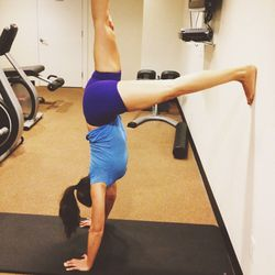 I do yoga first thing on Tuesday mornings, either at <strong>Yoga People</strong> down the block or in our building's gym. Here I am working on the handstand practice!