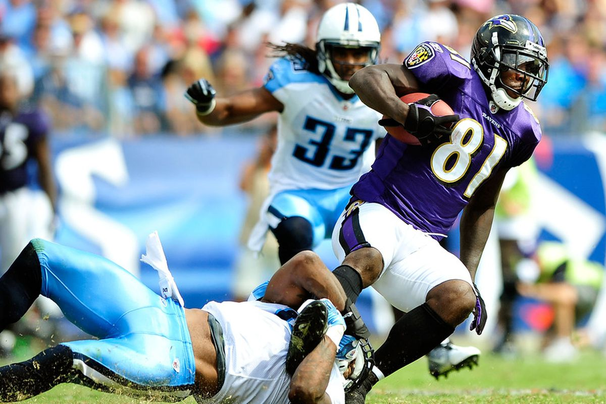 NASHVILLE, TN - SEPTEMBER 18:  Jordan Babineaux #26 of the Tennessee Titans tackles Anquan Boldin #81 of the Baltimore Ravens at LP Field on September 18, 2011 in Nashville, Tennessee. Tennessee won 26-13.  (Photo by Grant Halverson/Getty Images)