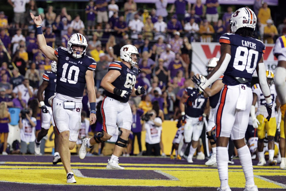 Auburn Tigers quarterback Bo Nix (10) reacts after scoring a touchdown against LSU Tigers during the second half at Tiger Stadium.