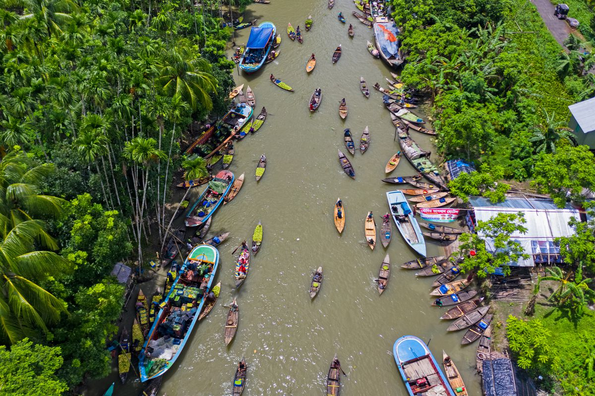 Aerial view of a river in Bhimruli, Jhalokathi, Bangladesh, where farmers and traders trade their guava.