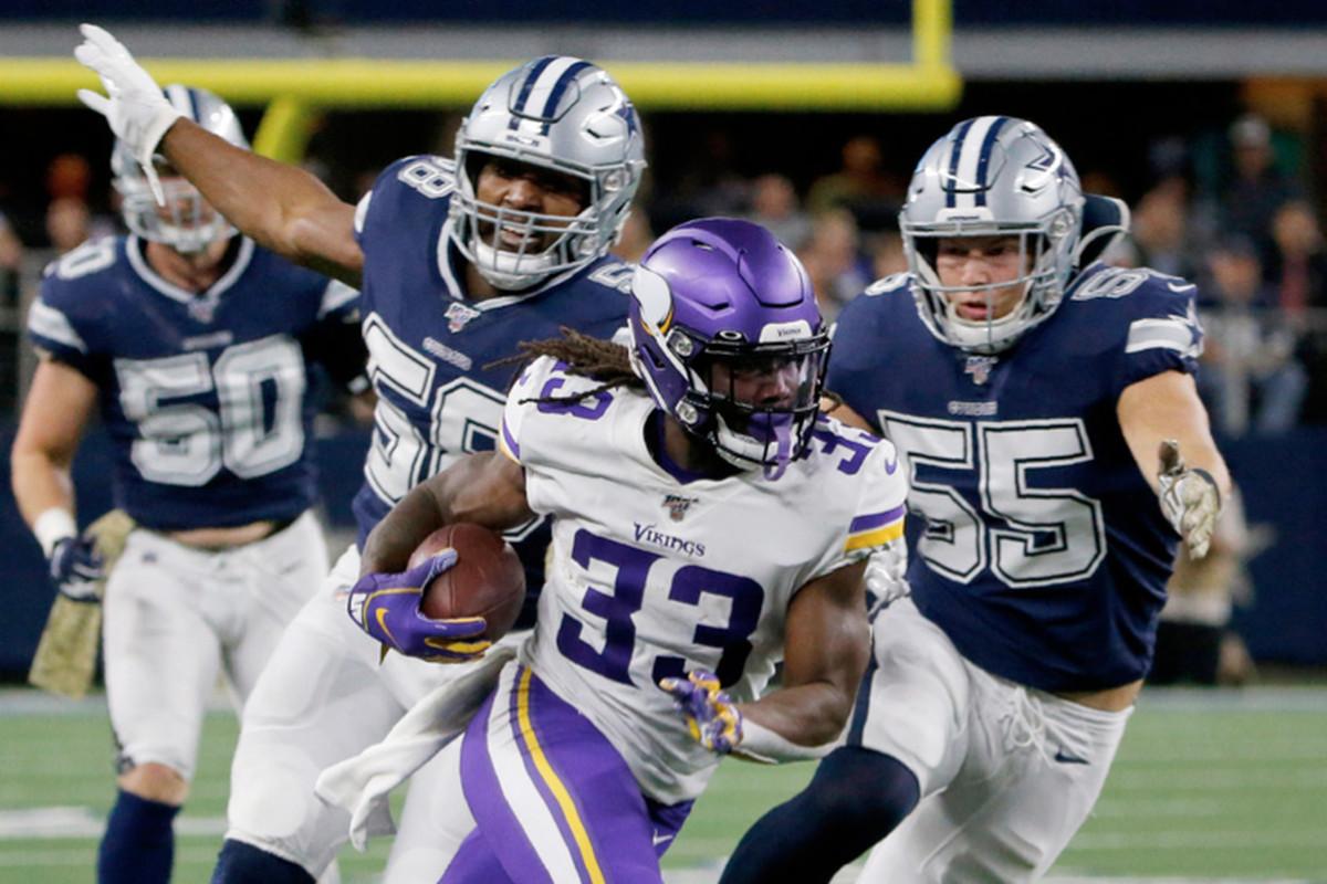 Vikings running back Dalvin Cook runs past the Cowboys' Robert Quinn (58) and Leighton Vander Esch on Sunday in Arlington, Texas.