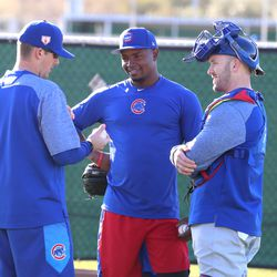 Randy Rosario (center) and Ian Rice (right) discuss the bullpen session they just finished at Riverview Park, the Spring Training home of the Chicago Cubs, in Mesa, AZ.   John Antonoff/For the Sun-Times