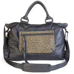 """Halle Berry is a huge fan of this Cleobella bag (<a href=""""http://shop.cleobella.com/collections/weekenders/products/lolita-stud-pocket#.UoJt05Tk_R0""""target=""""_blank"""">$591</a>) which comes with a detachable stud pouch that's perfect for a late-night jaunt."""