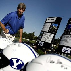 Prior BYU quarterback Gifford Nielsen signs helmets at Riverside Country Club in Provo as part of BYU's quarterback week on Friady September 3, 2010.  The event  raises athletic endowment funding.