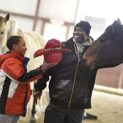 Carnell Harley, 9, of Pittsfield, Mass., left, and his father Carlton Harley take part in an exercise during a Berkshire HorseWorks open house on Saturday, March 18, 2017, at Berkshire Equestrian Center in Richmond, Mass.